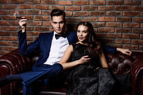 Couple in elegant evening dresses