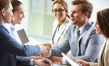 Businessmen handshaking at meeting