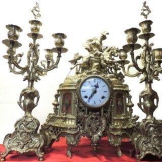 Trittico orologio con due candelabri