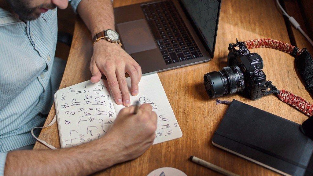 Man sketching logo ideas