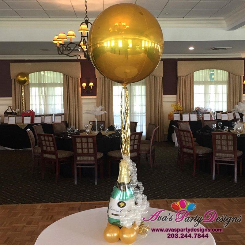 mini champagne bottle sculpture, orbz balloon centerpiece