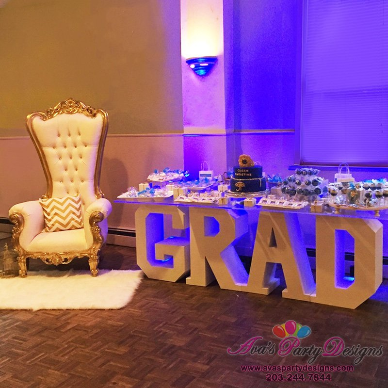 graduation party rentals, throne chairs, statement table, fabric backdrop