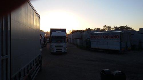 camion parcheggiati con insegna BOSCHI ADRIANO