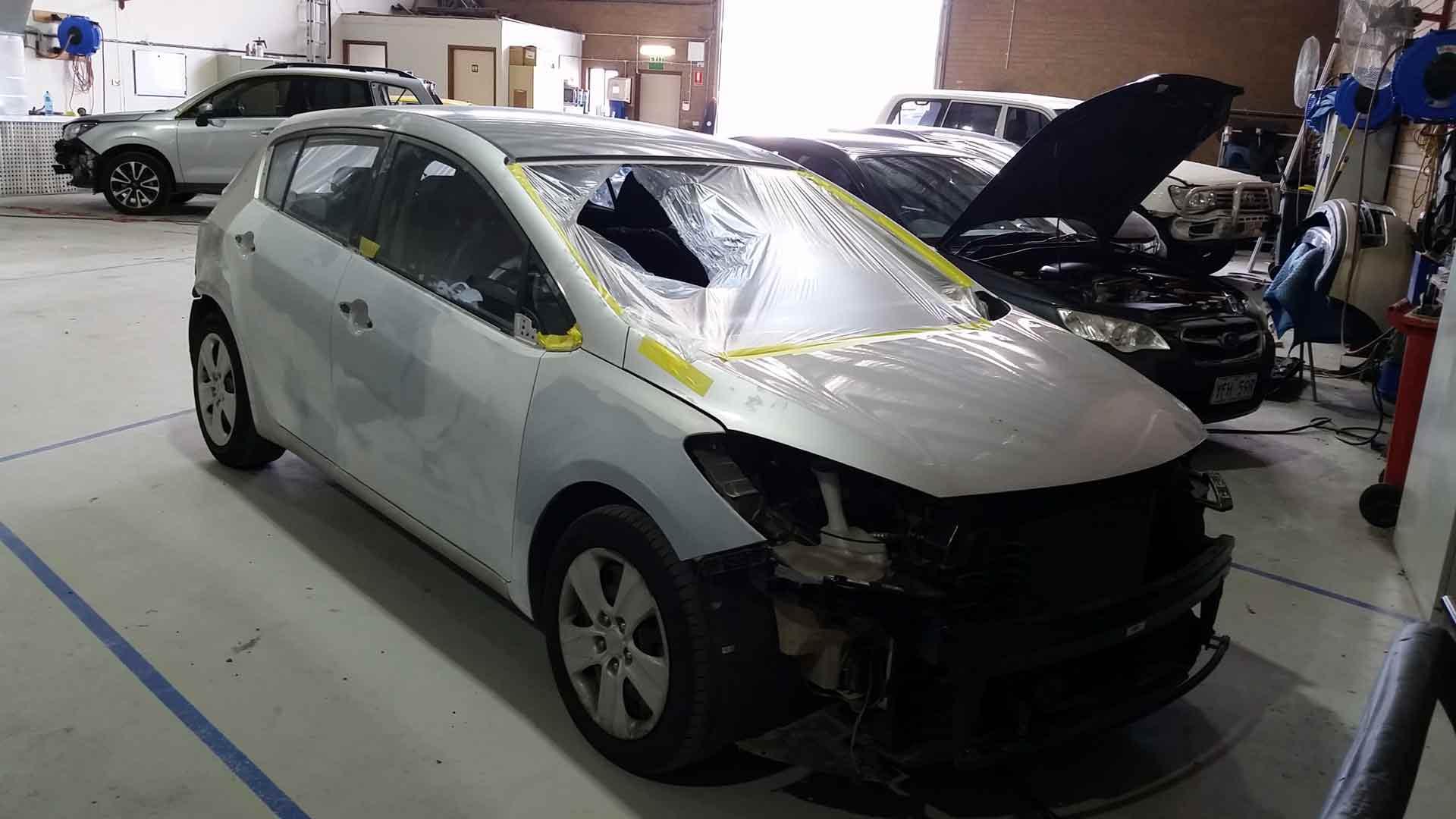 silver car in repair