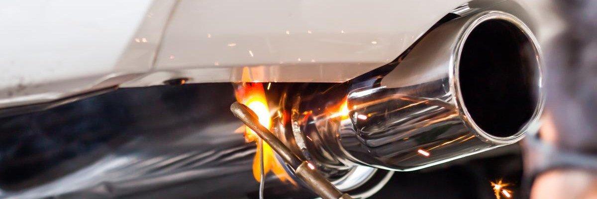 Mechanic Welding Muffler Exhaust Tip