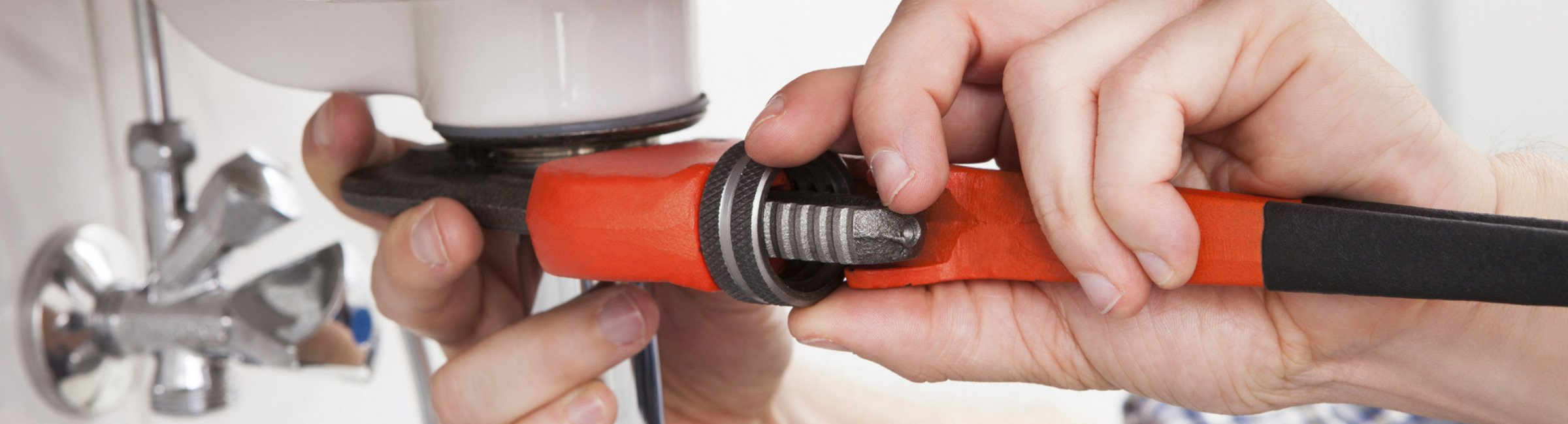 croydon plumbing and hot water plumber fixing a water sink
