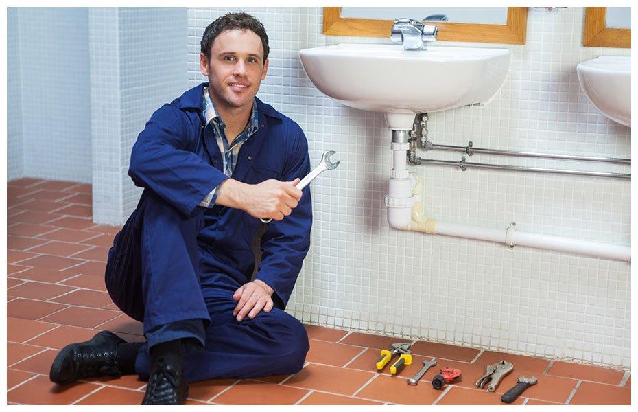 croydon plumbing and hot water plumber posing next to sink