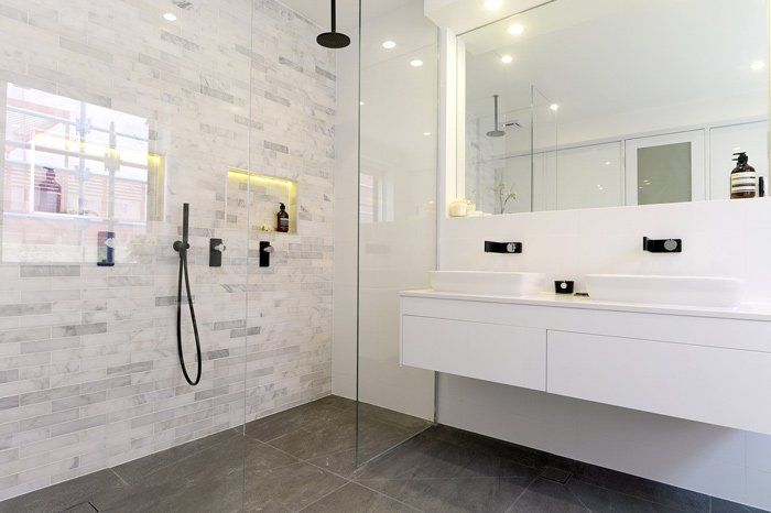 white modern bathroom with large mirror