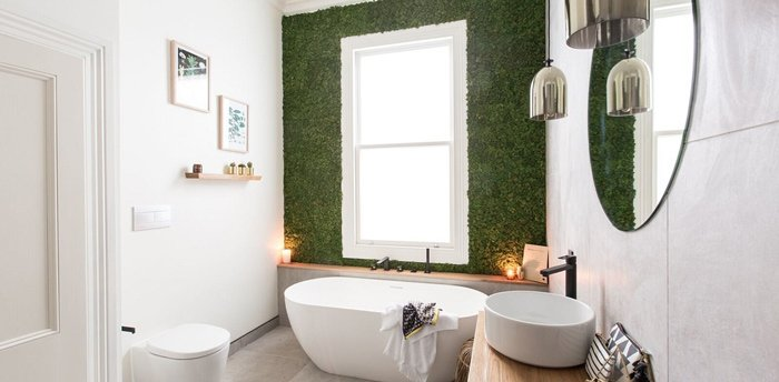 white bathroom with grass wall