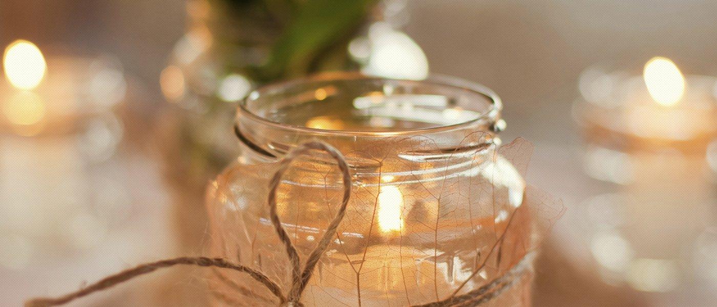 barattolo decorato con spago e candela