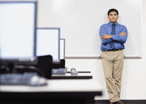 Man leaning against a whiteboard