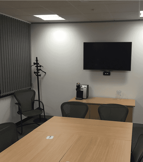 Meeting room with screen on the wall