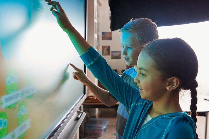 Children using touch screen