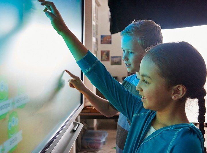 Children playing with touchscreen
