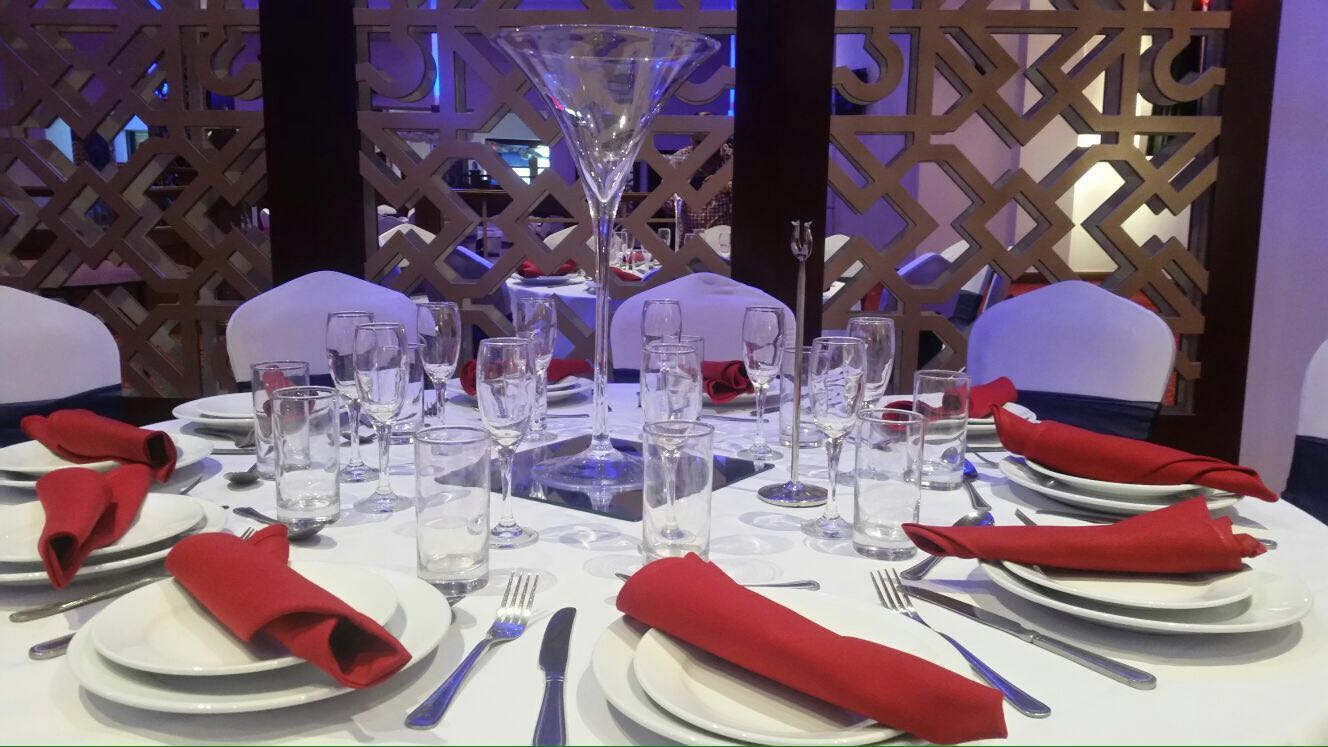 red cloth and white plates