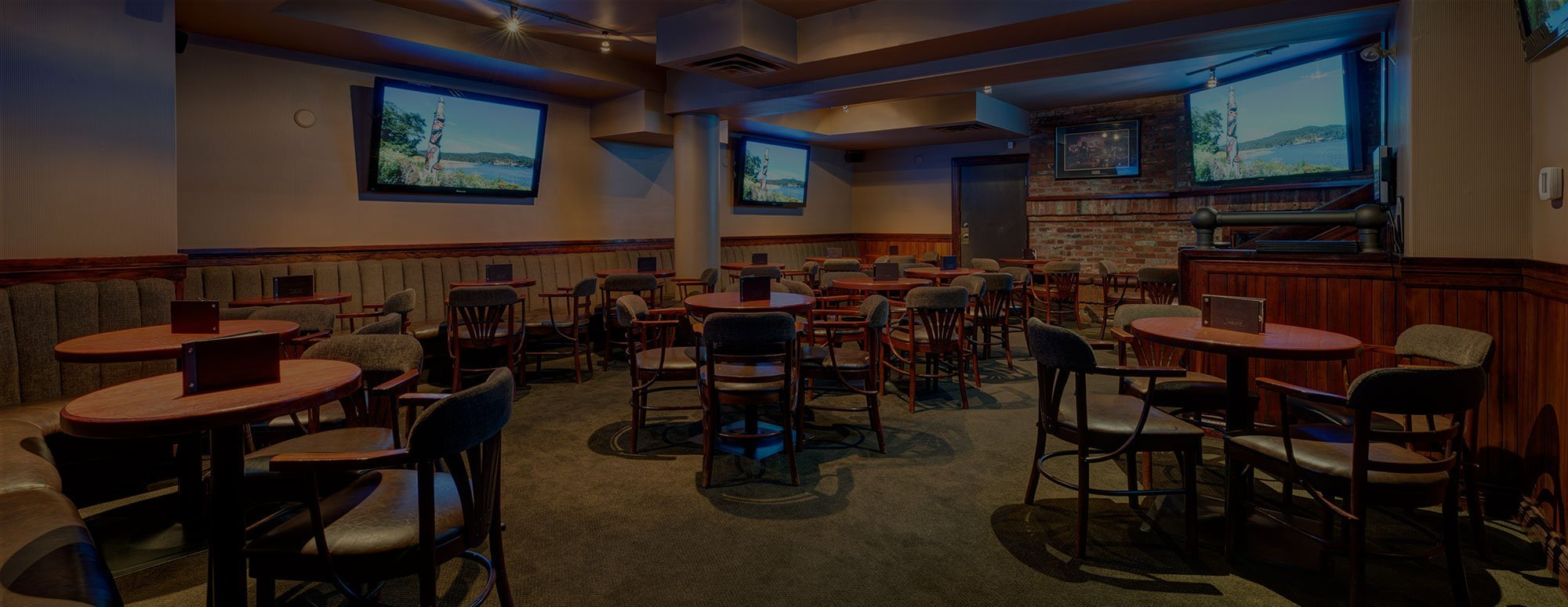 Tables and televisions in the bar