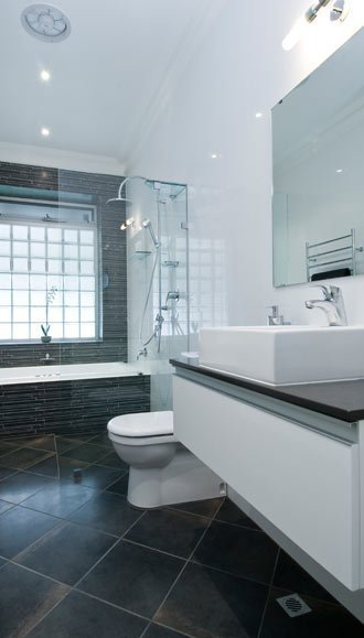 Sleek style bathroom tall image