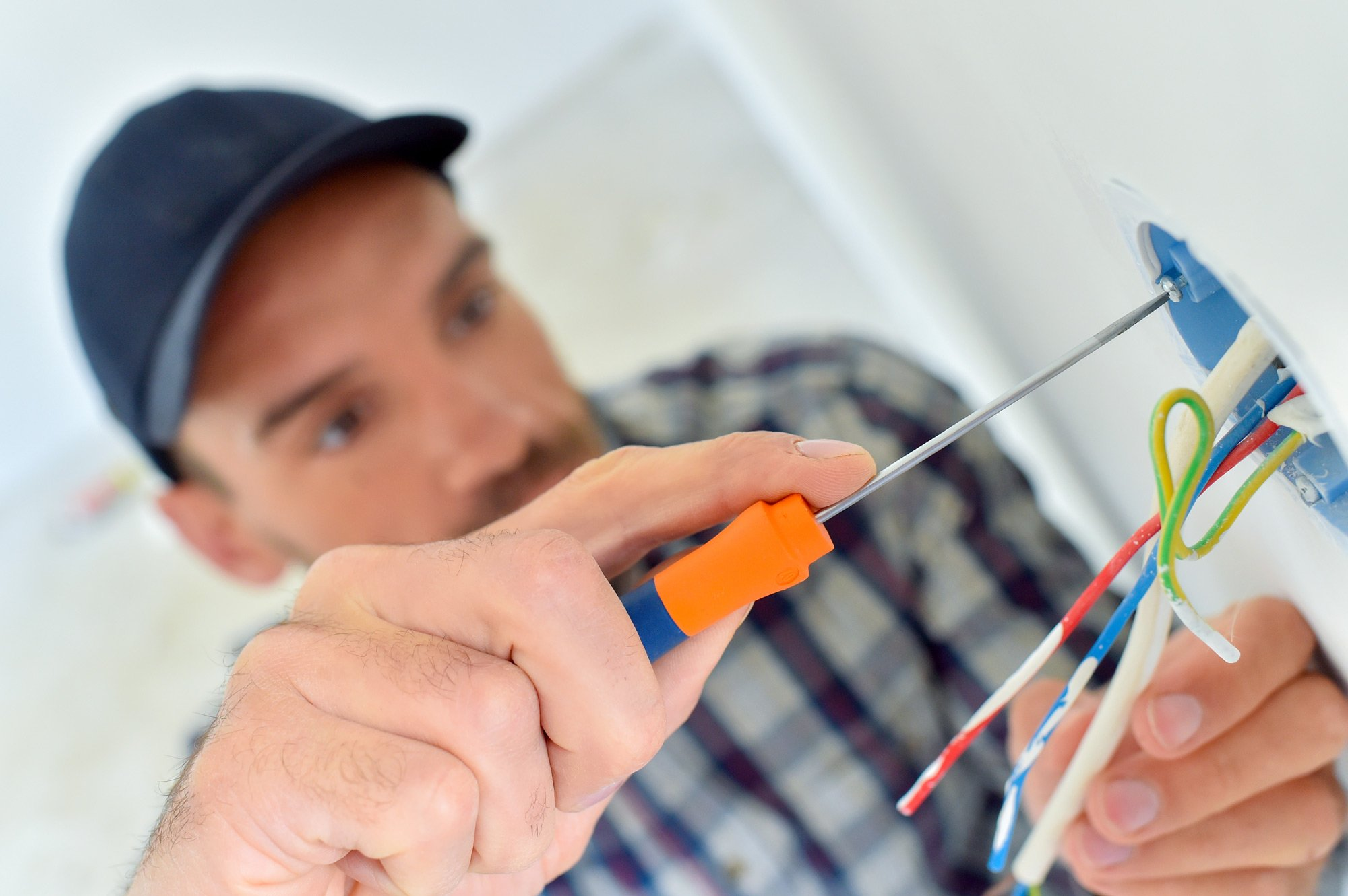 Professional doing the electrical repair