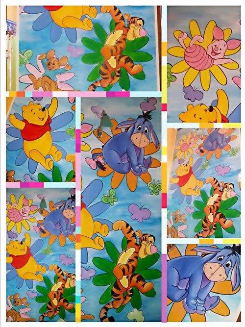 un collage che rappresenta i personaggi di Winnie The Pooh con una tigre arancione, un asinello azzurro e un orso giallo con una maglietta rossa