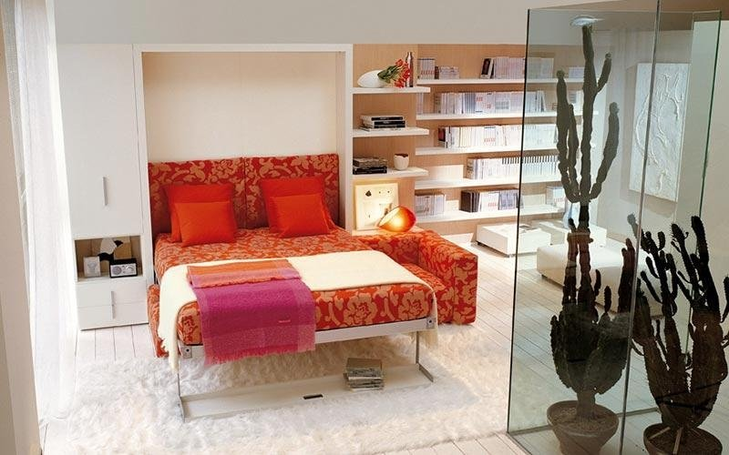 camera con letto con soppalco e libreria