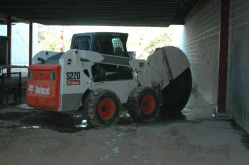 Bobcat used for cutting concrete in Omaha.