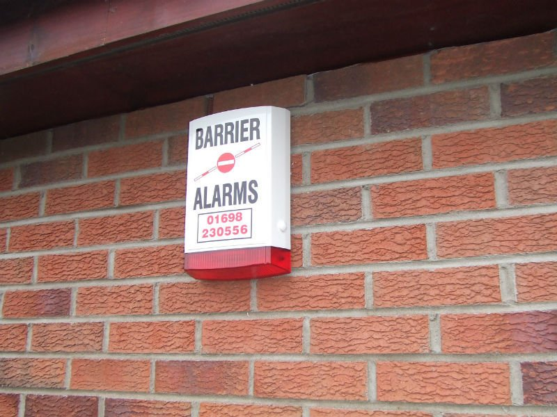alarm fitted on the brick wall
