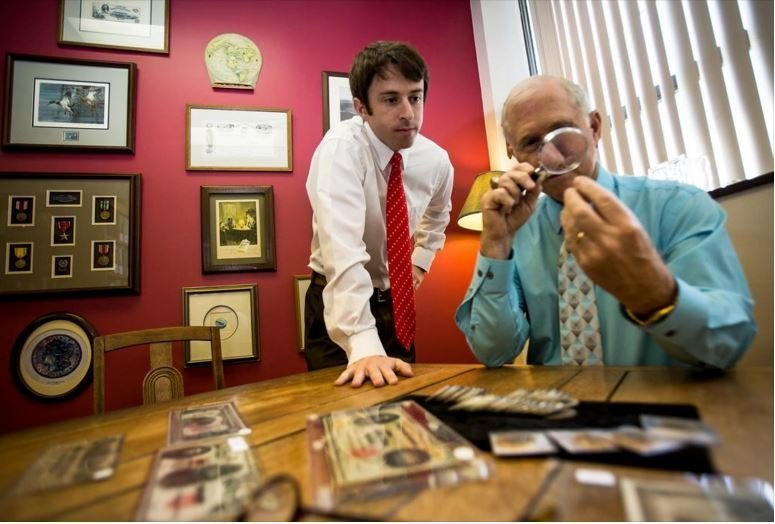 Doug and Austin Mattox reviewing coins