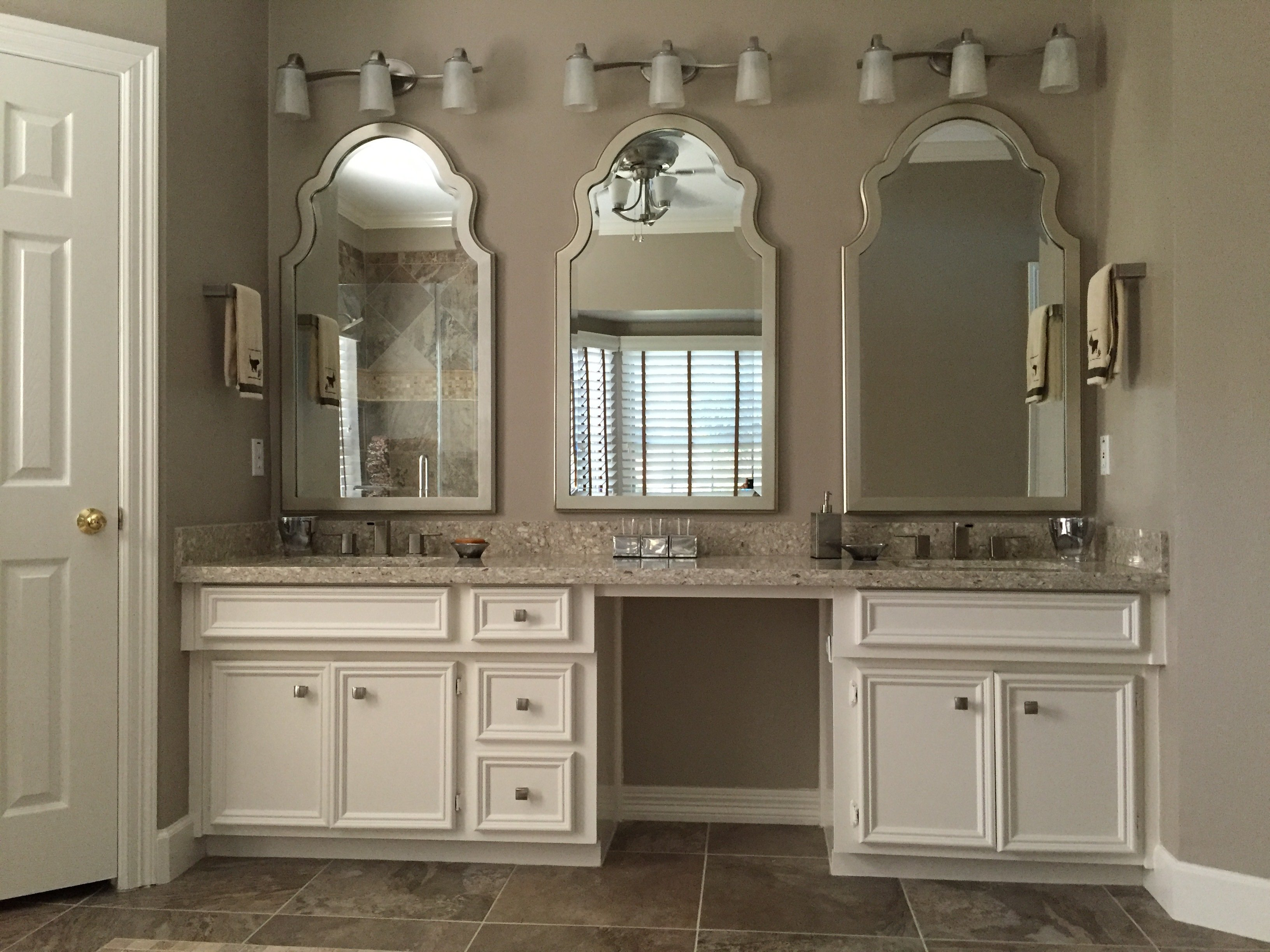 white cabinets and stone vanity