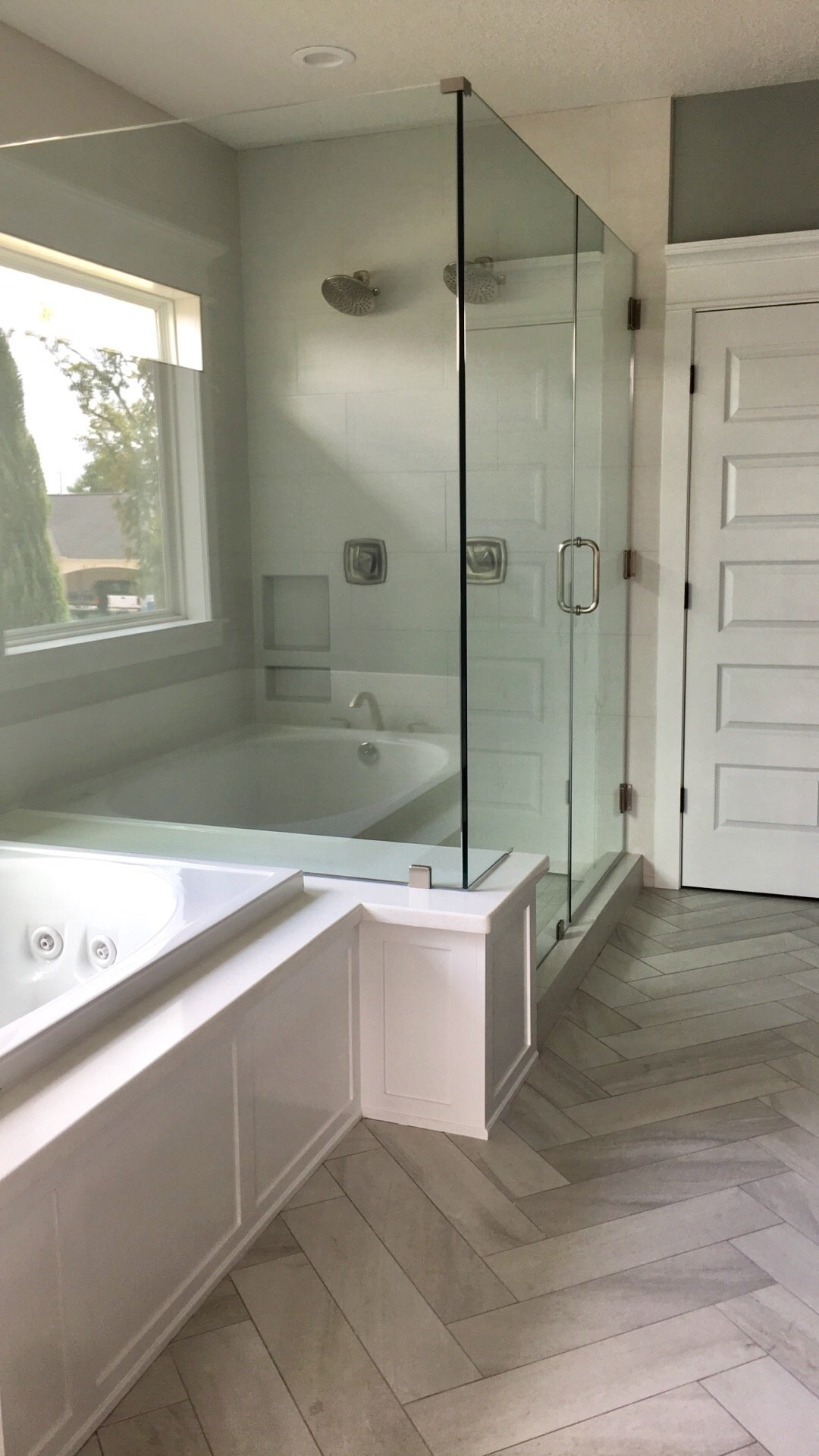 hardwood flooring and glass shower