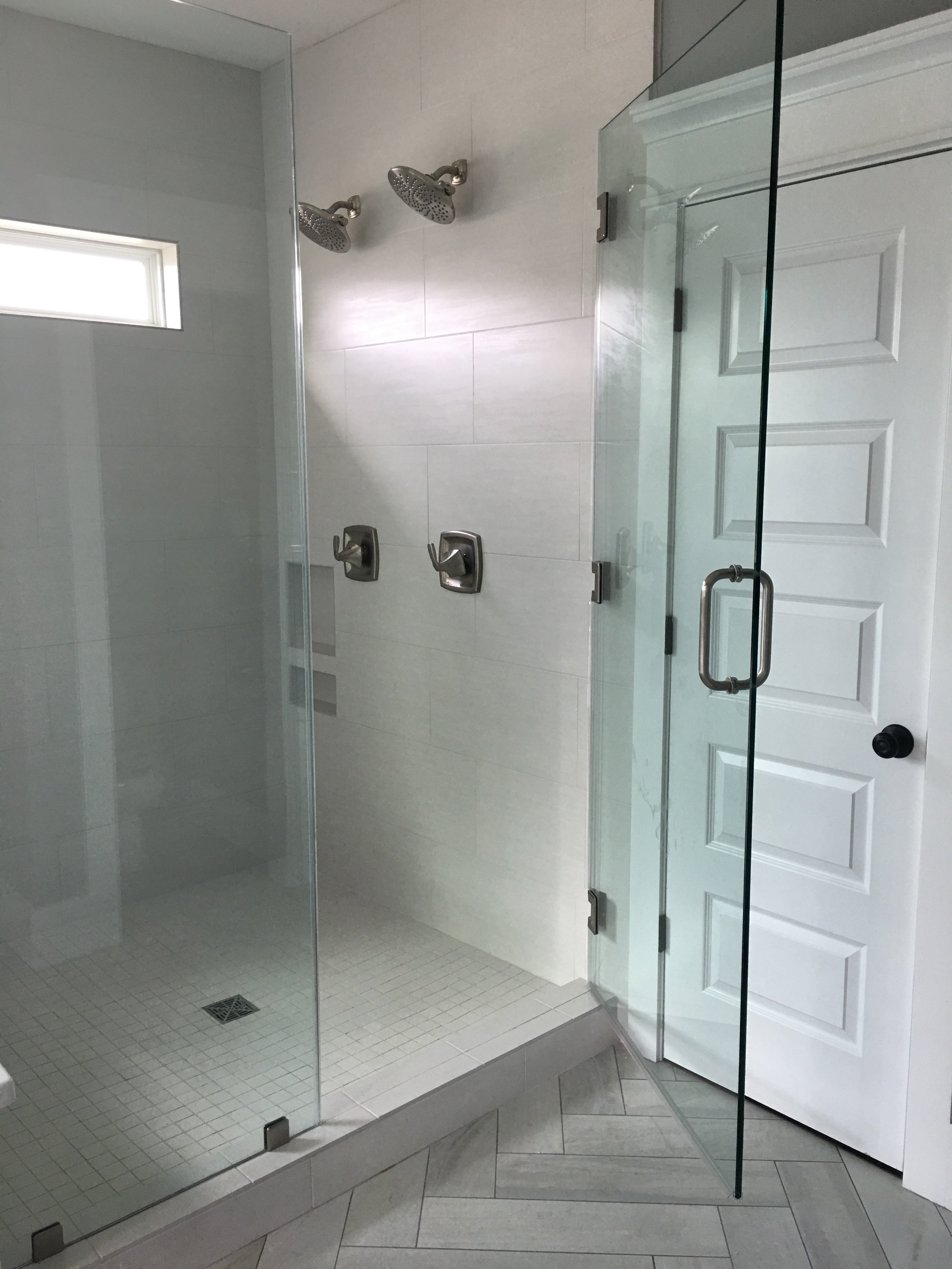 white tile and glass shower