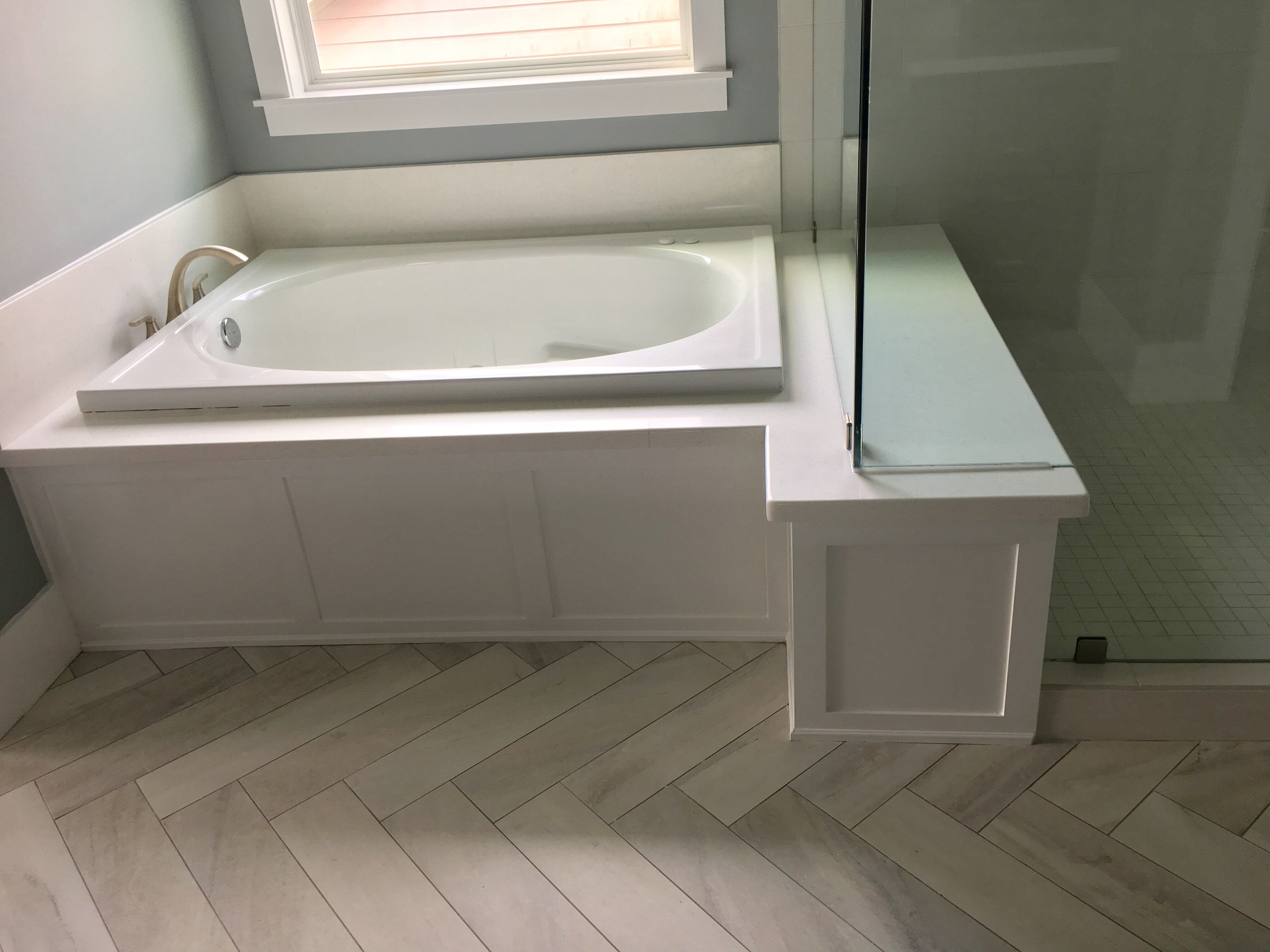natural hardwood flooring and tub