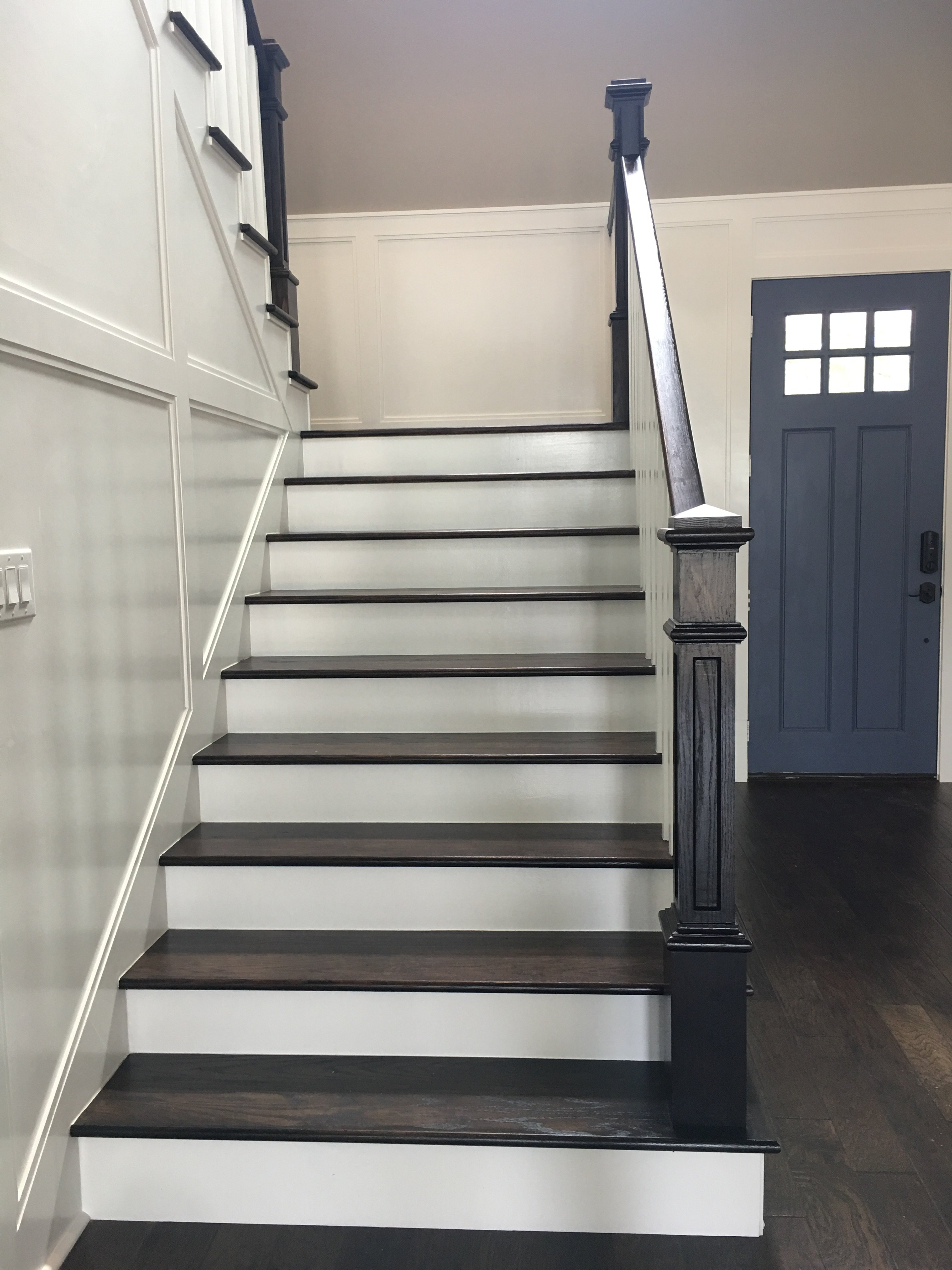 white and brown hardwood stairway
