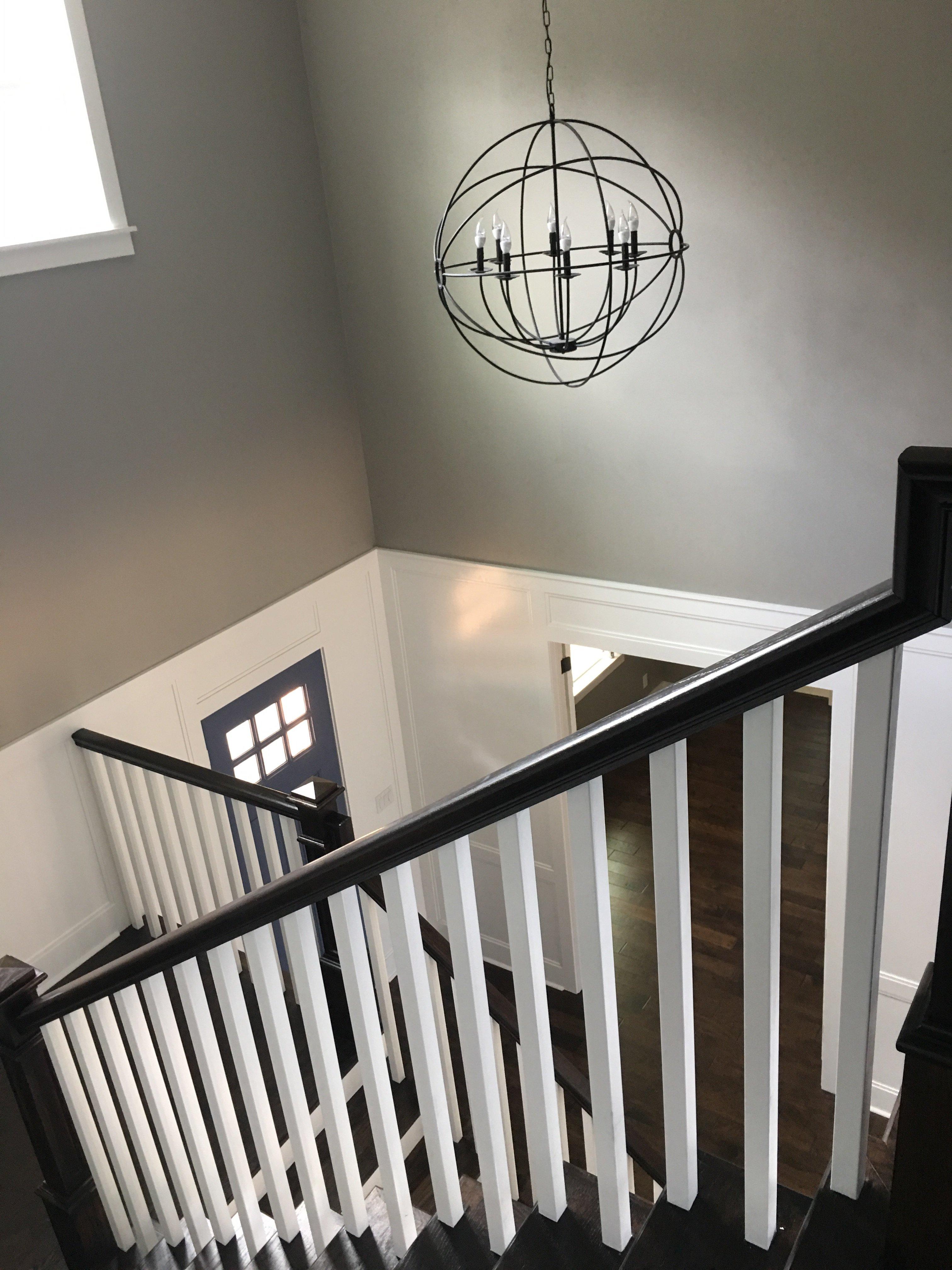 Wood stairway with white railings