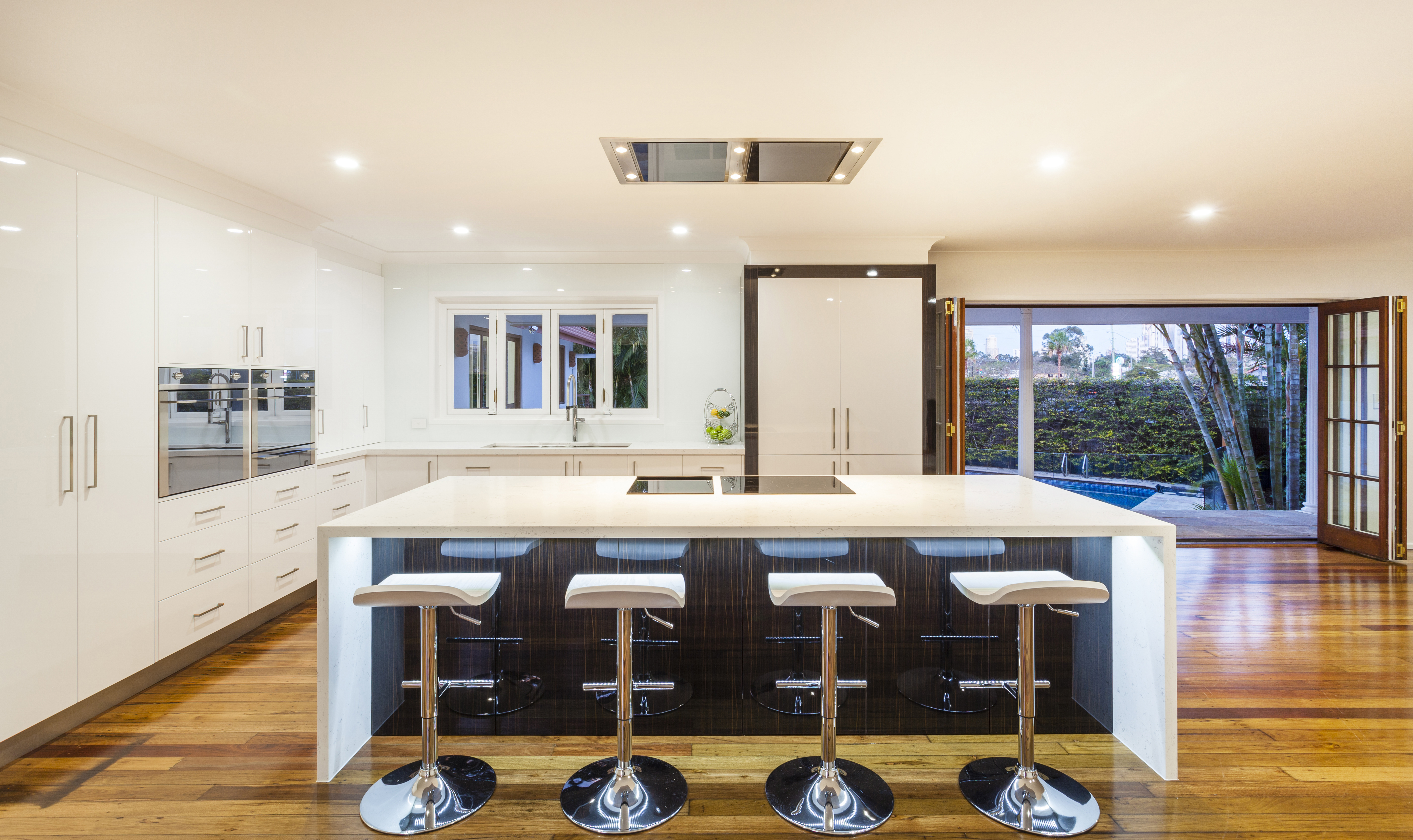 A lovely stylish kitchen with a breakfast bar and leather stools