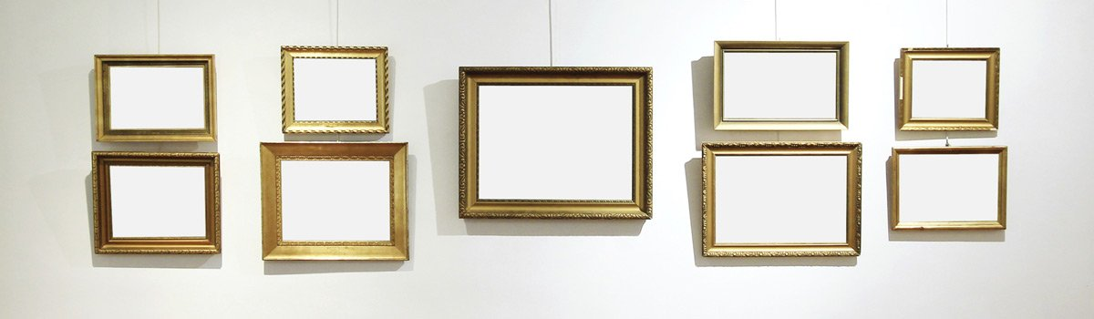 different shape frames hanging on wall