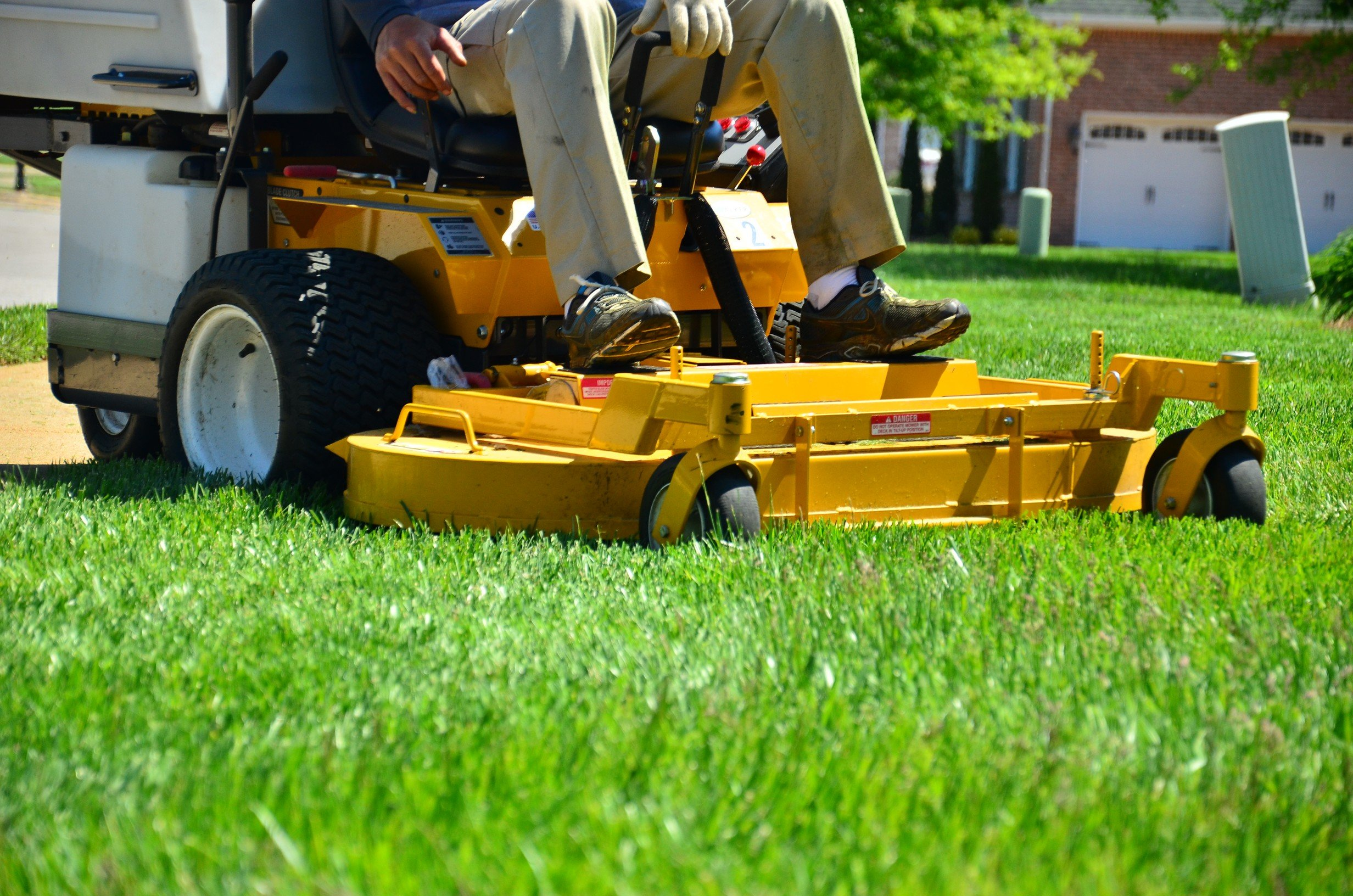professional lawn care mower, riding a commercial mower
