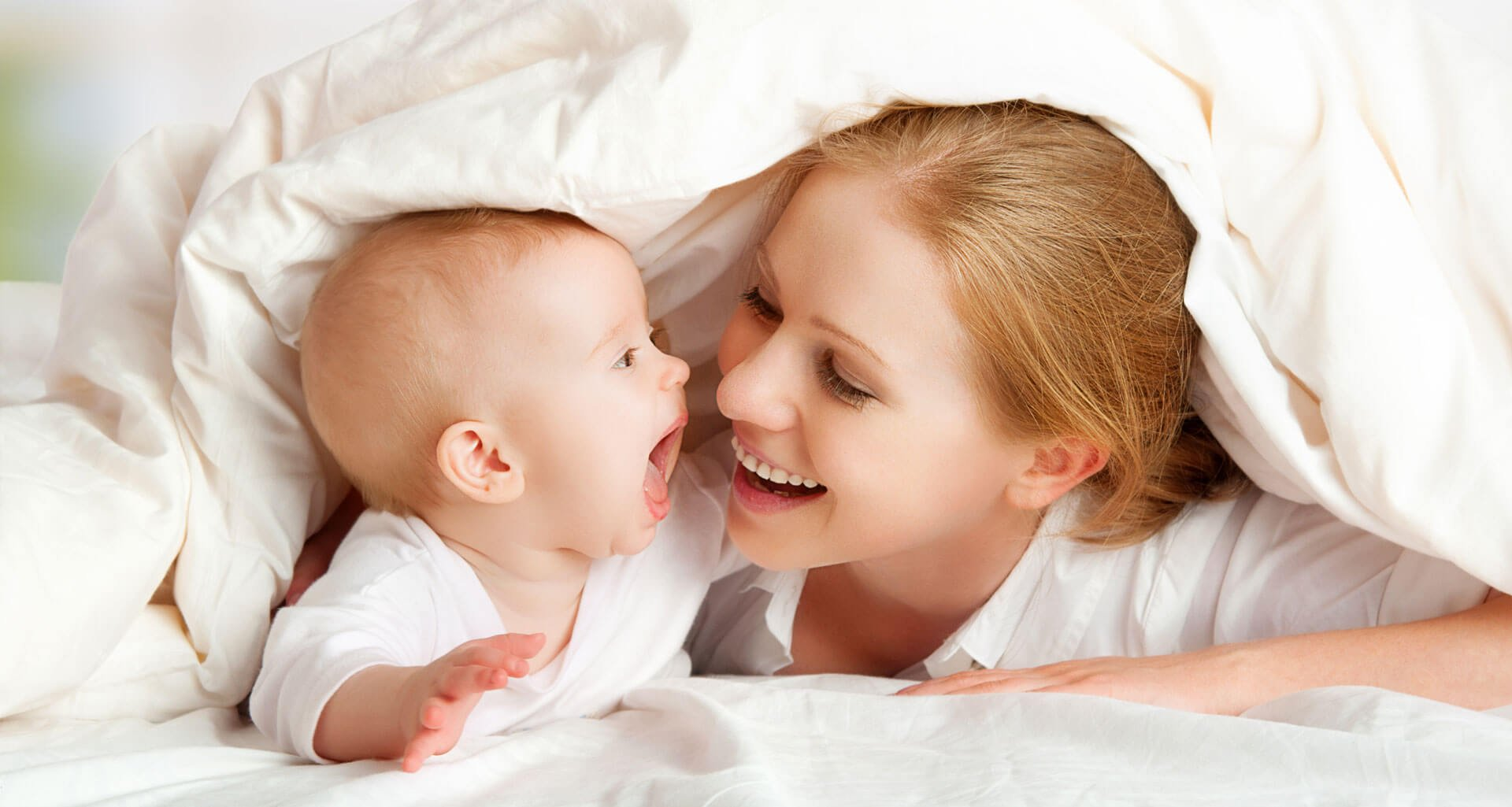 mother laughing with her child