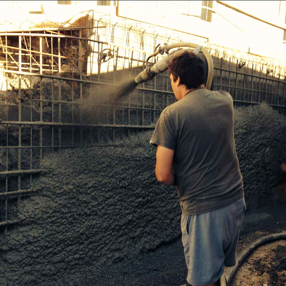 spraying concrete onto a retaining wall