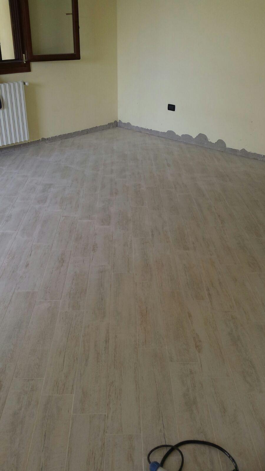 posa rivestimento pavimento