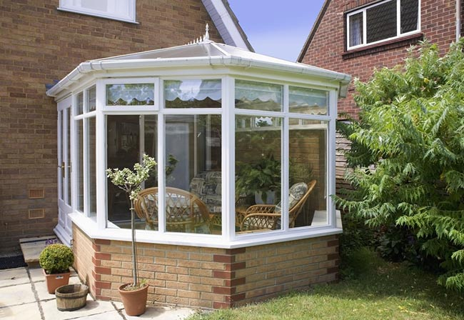 upvc conservatory with chairs inside
