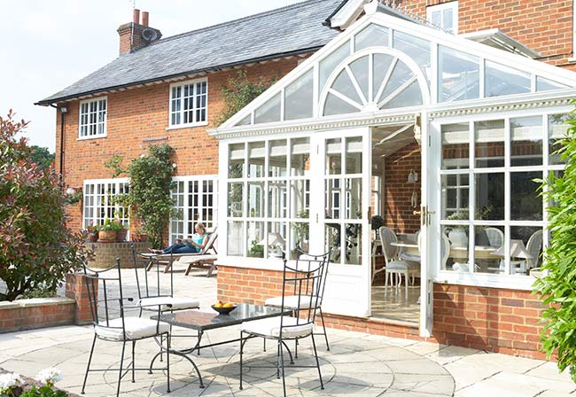 large upvc conservatory at the back of a property