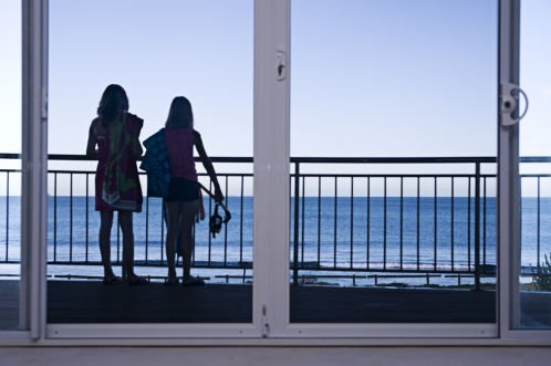 two girls looking out at an ocean view