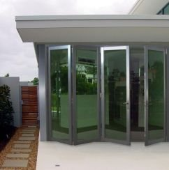 metal trimmed accordion glass doors