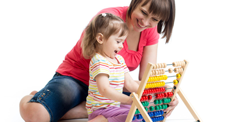A child playing with her carer