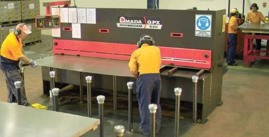 australian general engineering metal sheet inserting into machine