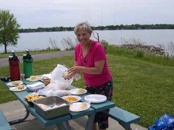 Old lady organizing food outside