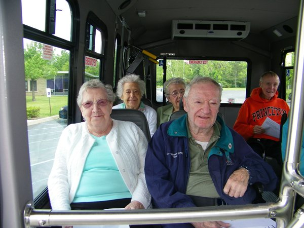 Old people traveling in a bus for an event