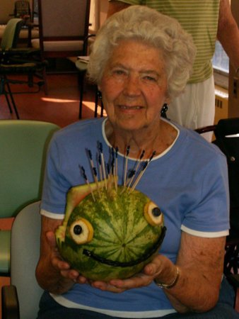 Old lady with decorated watermelon
