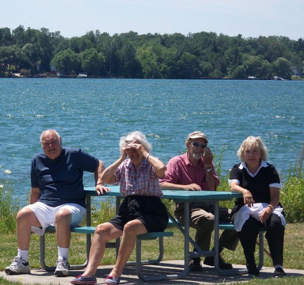 Senior people near water and relaxing