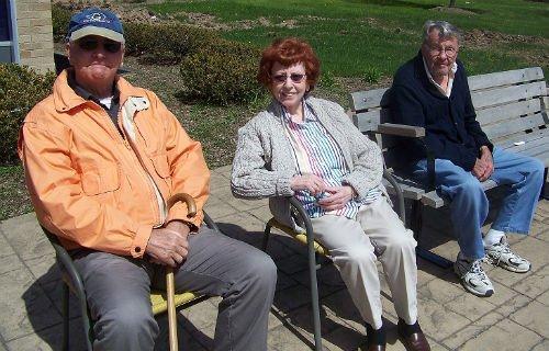 Senor people relaxing in the sun
